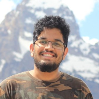 Computer engineering student standing in front of mountain