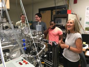Professor Carmen Menoni and research students posing for picture in laboratory