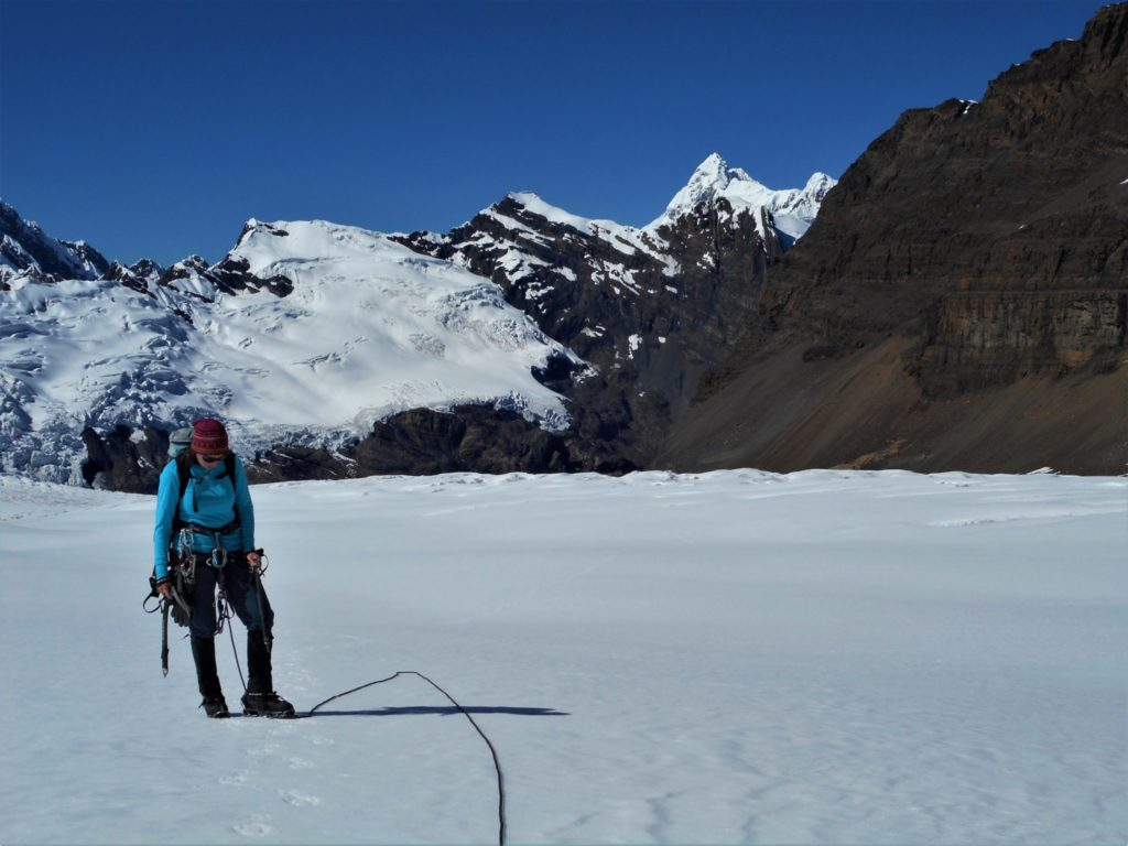 Image of Megan Emmons, an electrical engineering PhD student climbing mountain