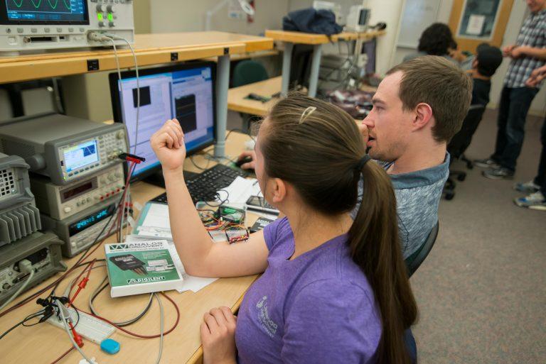 Undergraduate ECE students conducting experiment