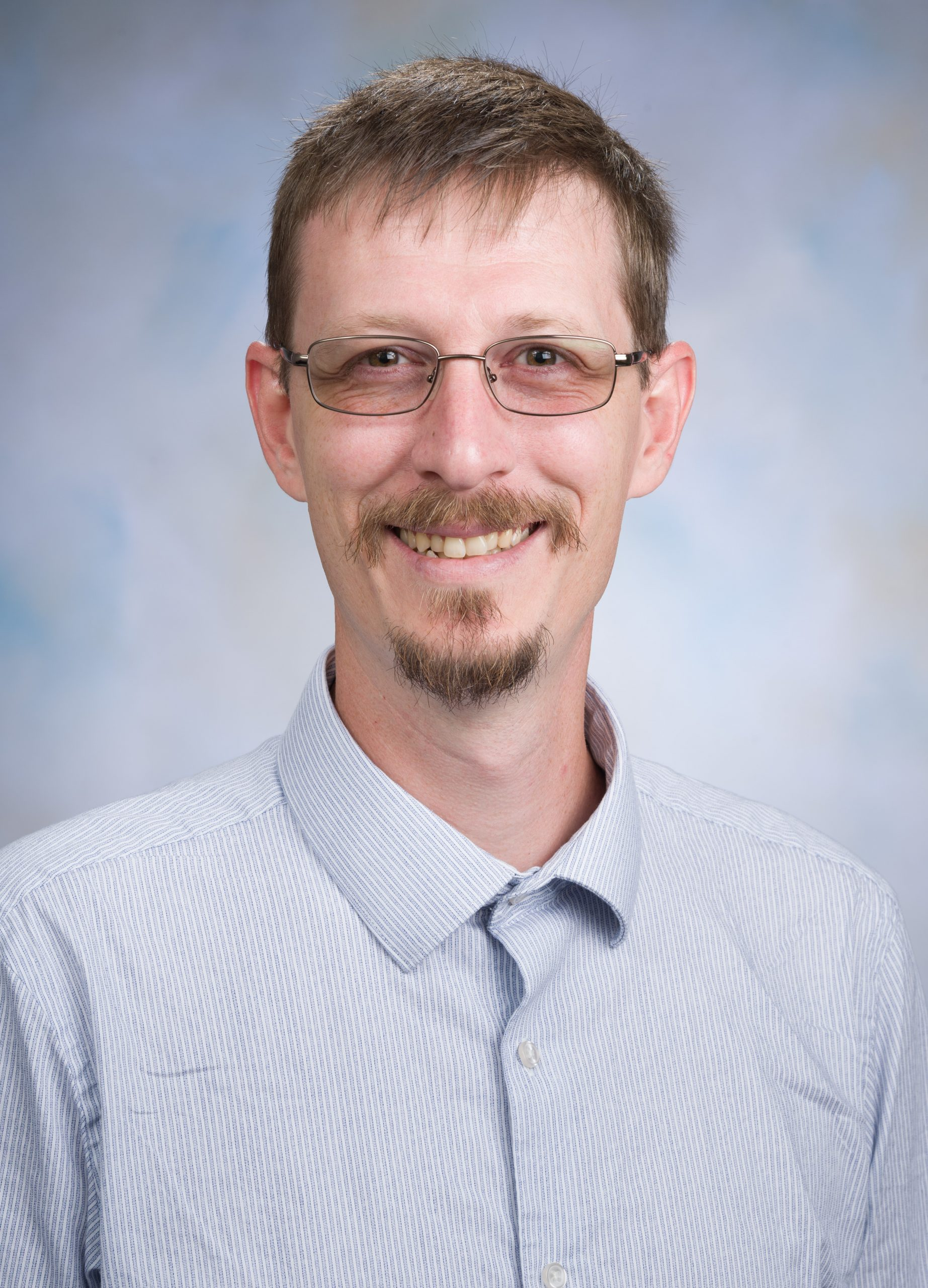Professional headshot of ECE master's student John Crowell