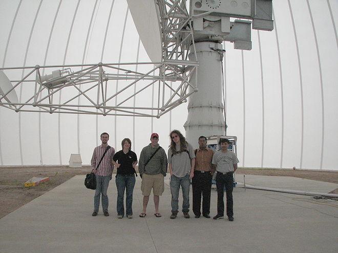 Undergraduate researchers at a radome facility