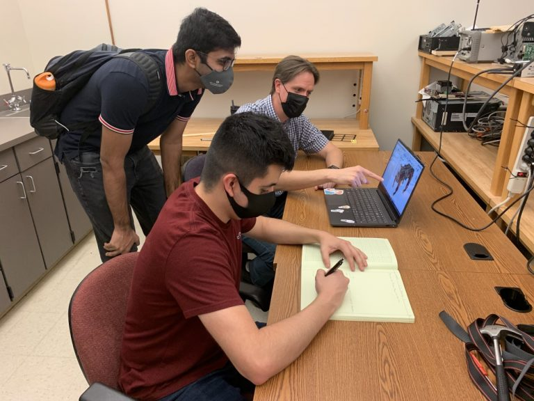 Engineer in Residence volunteer helps students with design project