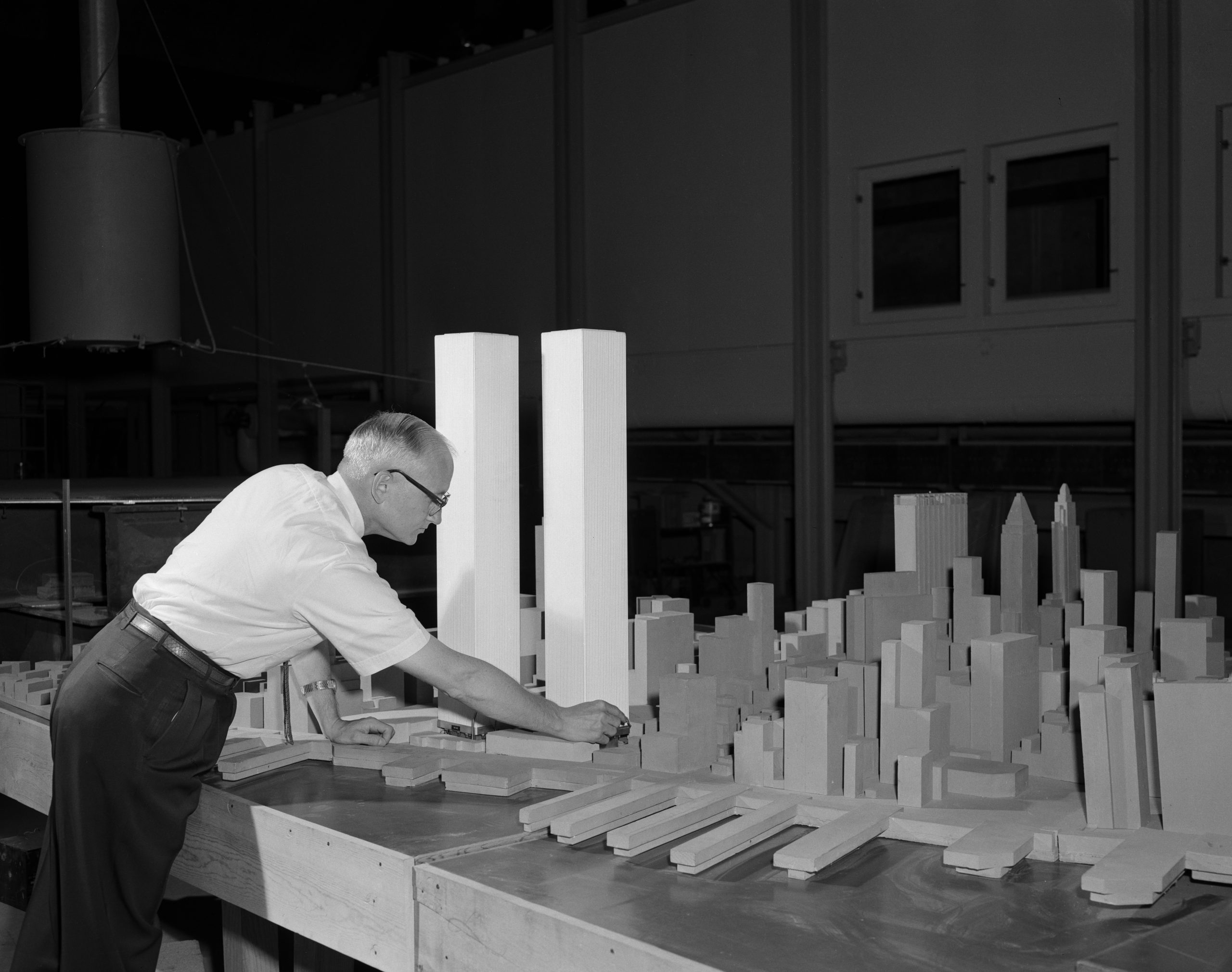 Photo of Dr. Jack E. Cermak of Civil Engineering working on a scale model of the New York City World Trade Center towers for Wind Tunnel experiments on July 26, 1965.