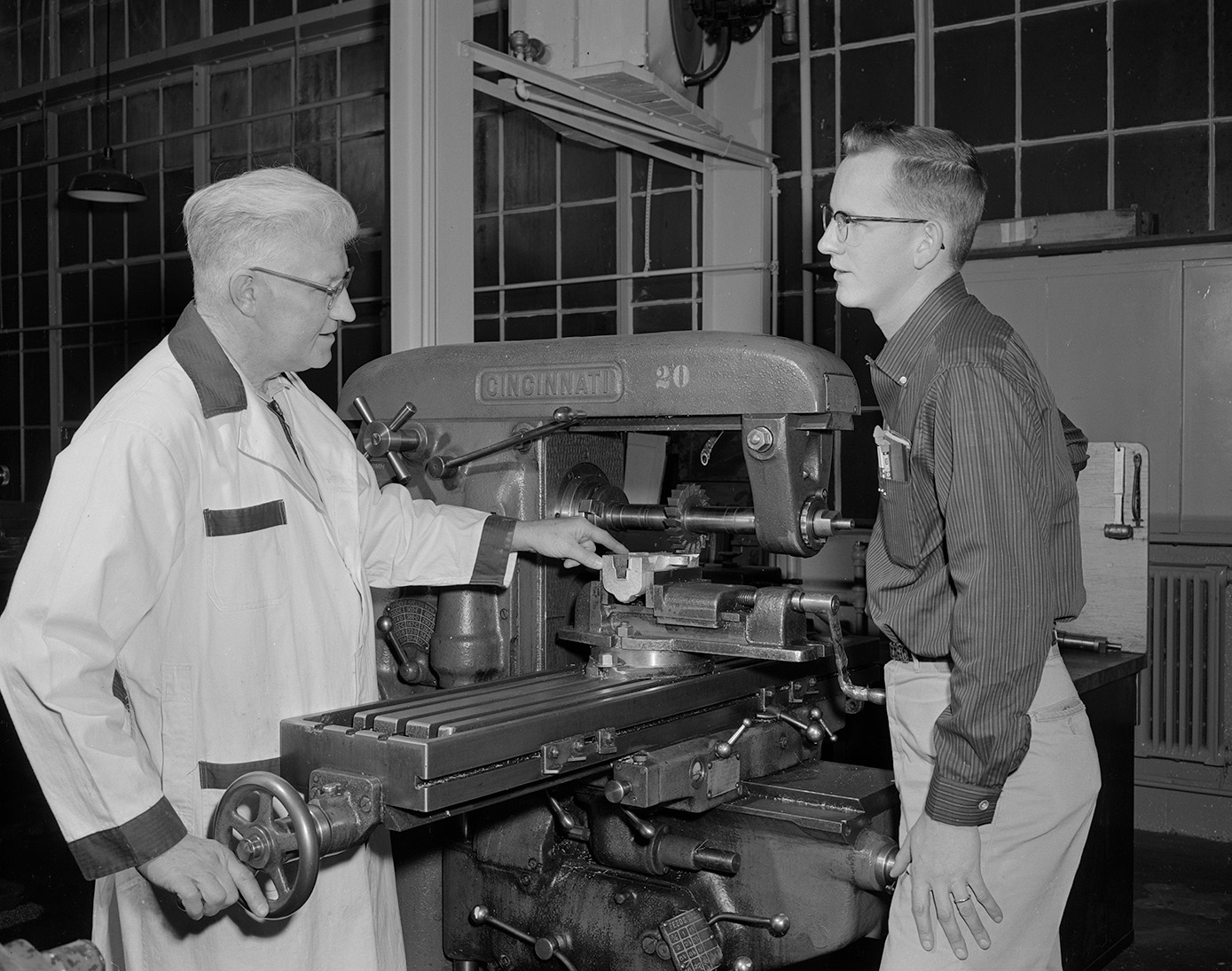 """Negative sleeve reads """"12.11.58 Keicki N., Mr Dodge and students in machine shop."""""""