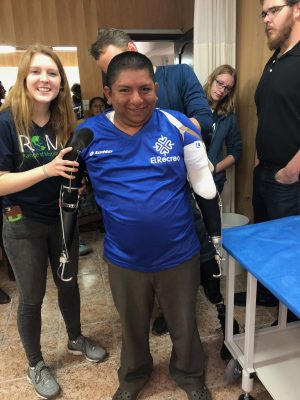 CSU student pictured with double-amputee wearing prosthetic implants.