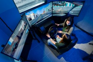 Erika Miller, Assistant Professor in the Systems Engineering department in the Walter Scott, Jr. College of Engineering works with test student on drive simulator, December 17, 2020.