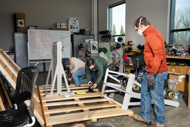Jeremy Daily, Assistant/Associate Professor-Cyber Security in the department of Systems Engineering in the Walter Scott, Jr. College of Engineering works with graduate students in putting together test platforms for his research at Colorado State University's Powerhouse, December 17, 2020.