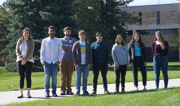 Student team from the MAP-HABS project standing outside smiling.