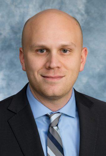Professional indoor headshot of Dan Herber
