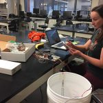 CSU student Megan Miller works on the electrical components of her team's project, a physically pulsating organ model.