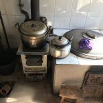 Traditional coal and biomass heating and cooking stoves.
