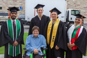 New CSU mechanical engineering alumni – Younis Al Masoudi, Drew Caldwell, Billy Anthony and Shura Al Maawali – delivered a modified wheelchair to Fort Collins resident Wanda Roche at graduation May 17.