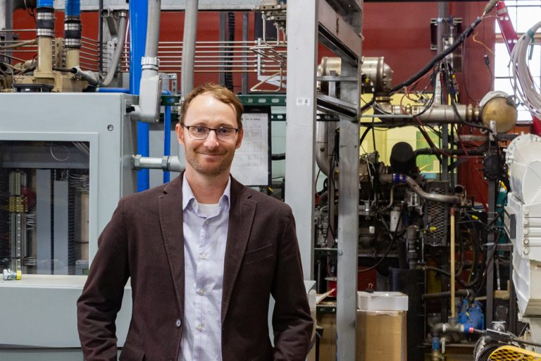 Mechanical engineering assistant professor Bret Windom stands in the engines lab at the CSU Powerhouse Campus, September 27, 2019.