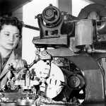 Female mechanical engineering student using a lathe in 1943