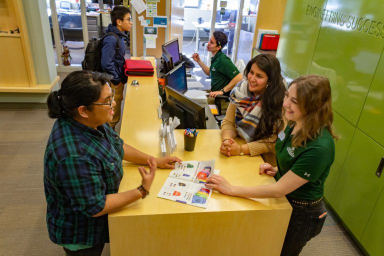 Outreach and Equity Coordinator Claudia Hernandez works with student ambassadors Camille Milo and Katy Rodriguez in the Engineering Success Center, January 2020