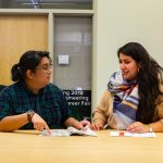 Outreach and Equity Coordinator Claudia Hernandez works with student ambassador Camille Milo in the Engineering Success Center, January 2020