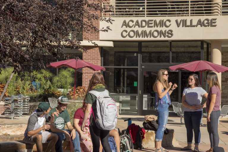Students in front of Academic Village on campus.