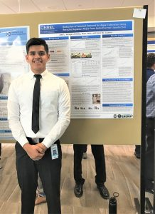 Juan Venegas next to his poster at the NREL internship presentation event, summer 2018; photo courtesy Juan Venegas