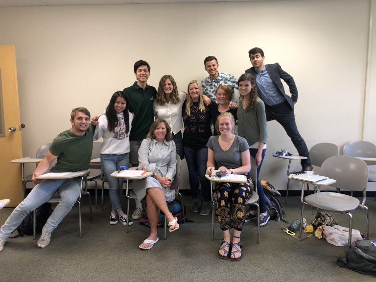 Group photo of students in a classroom.