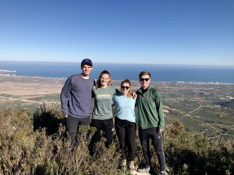 Four CSU students pose on a hike in Spain