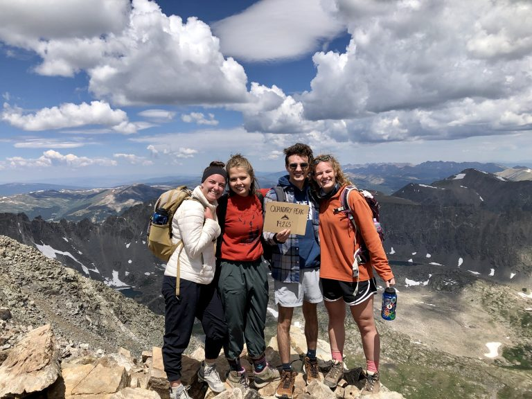 Four friends on a mountain.