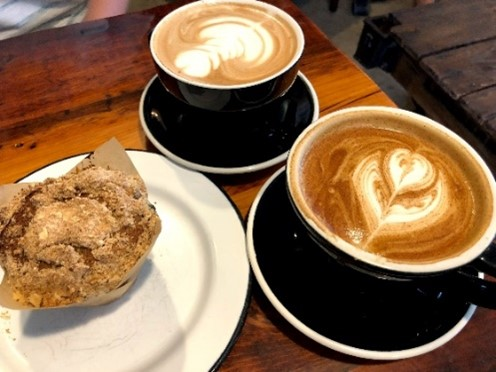 A photo of coffee and a biscuit from Bindle in Fort Collins