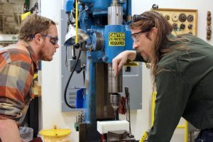 Mechanical Engineering Laboratory Support Engineer Ryan Saunders with undergraduate student, drill press instruction Engineering Manufacturing Education Center teaching laboratory January 2020